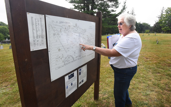 BRYAN EATON/Staff Photo. Jane Snow has been working to improve Union Cemetery in Amesbury and created this map showing different graves, making it easier for people to find relatives or historical research.