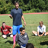 BRYAN EATON/Staff Photo. Pentucket High boys soccer head coach Christian Langlois talks with the players after practice.