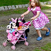 BRYAN EATON/Staff Photo. Eliza Towne, 3, of Rowley is all about Minnie Mouse as she makes her way around Atkinson Common in the Carriage and Bike Parade.
