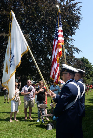 BRYAN EATON/Staff Photo. The colors were presented by Fireman Curtis Williamson, right, and Seaman Zachary Prentice of U.S. Coast Guard Sation Merrimack for the playing the Star Spangled Banner.