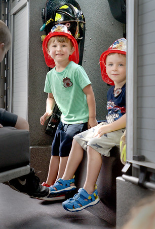 BRYAN EATON/Staff Photo. Spencer Gilman, 3, of Danvers, whose grandparents live in Newburyport, and friend Zachary Soucy, 3, also of Danvers check out a Newburyport Fire Department engine.