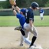 CARL RUSSO/Staff photo Manchester Essex Mariners, Kellen Field is unable to beat the throw to first and is called out as Rowley's Joe White catches the throw to first. The Rowley Rams defeated the Manchester Essex Mariners 6-2 in baseball action of game four of the ITL Finals.  8/17/2019