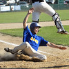 CARL RUSSO/Staff photo Rowley's Tim Cashman slides hard into home plate to score one of the six runs the Rams scored in the sixth inning. The Rowley Rams defeated the Manchester Essex Mariners 6-2 in baseball action of game four of the ITL Finals.  8/17/2019