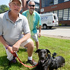 BRYAN EATON/Staff Photo. Poppy, shown with handler Dan Kinsell, left, and Mark Hatem, wears a camera on his back and will be making dogs eye view for Salisbury Community Television.