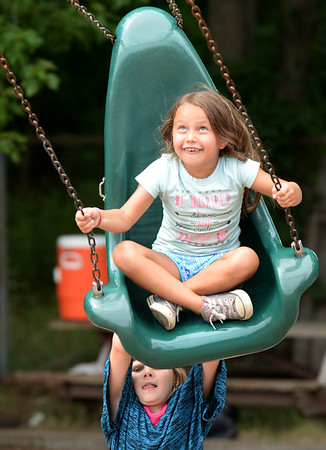 BRYAN EATON/Staff Photo. Amarah Boudreau, 6, of Amesbury gets pushed by her friend Alexa Heywood, 7, of Salisbury at the playground at the Boys and Girls Club. They had just come back from Ice Cream Tuesdays at Hodgie's Two where Amarah got black raspberry and Alexa cookie monster.