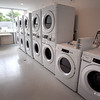BRYAN EATON/Staff Photo. The laundry room at the Residences at Salisbury Square.