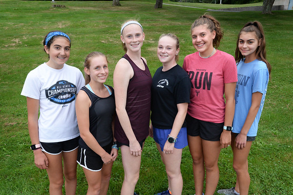 BRYAN EATON/Staff Photo. Triton standout runners, from left, Ellie Gay-Killeen, Sarah Harrington, Kerry Power, Laney Towle Ella Visconti and Isabella Silva. Missing is Kylie Lorenzo.