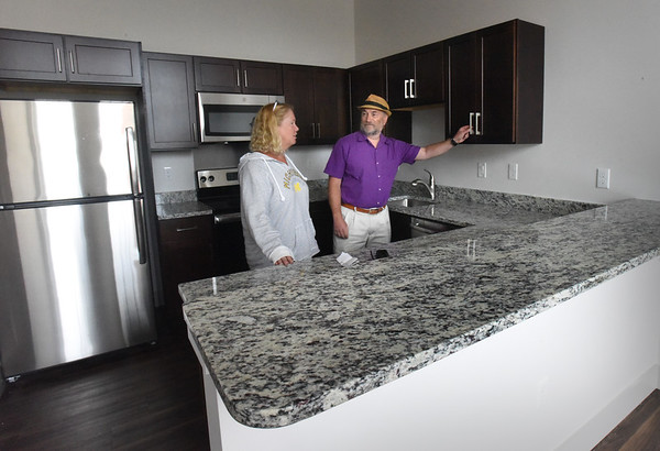 BRYAN EATON/Staff Photo. The YWCA's Diane Sagaser and John Feehan show off the kitchen of a yet-to-be-rented two-bedroom apartment.