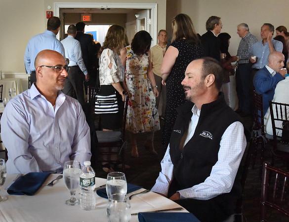 BRYAN EATON/Staff Photo. M. K. Benatti owner Matthew Khatib, left, and Grog owner Bill Nichelmann, chat before breakfast.