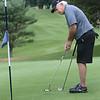 Bryan Eaton/Staff photo. Charlie Noonan of Newburyport putts on the ninth hole.
