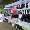JIM VAIKNORAS/Staff photo Sign at the Hot Dog stand at Yankee Homecoming's Old Fashioned Sunday on the Bartlet Mall in Newburyport. The stand was named for long time volunteer Frank Ventura who passed away on July 17th of this year.