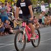 BRYAN EATON/Staff photo. Slow Bike Race winner Alex Dardinksi pulls across the finish line in the final heat.