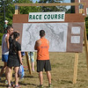 JIM VAIKNORAS/Staff photo Runner check out the map of the Yankee Homecoming road race course Tuesday.