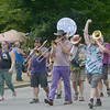JIM VAIKNORAS/Staff photo.The Party Band dances their way down High Street during the Annual Yankee Homecoming Parade.
