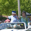 JIM VAIKNORAS/Staff photo.Homecoming King and Queen Ben Iocono and Jan Kolman wave to the crowds as they drive down High Street during the Annual Yankee Homecoming Parade.