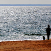 Salisbury: A woman walks her dog on a bright cold Sunday morning on Salisbury Beach. Jim Vaiknoras/staff photo