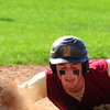 JIM VAIKNORAS/Staff photo Newburyport's Dan Baribeault dives safely back to first during the Clipper's game at Georgtown Thursday.