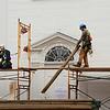 JIM VAIKNORAS/Staff photo Workers remove scaffoling from the Unitarian Universalist Church on Pleasant Street in Newburyport Friday.