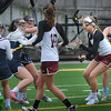 BRYAN EATON/Staff Photo. Newburyport's Molly Rose Kearney looks to make a shot on goal though Lynnfield defenders.