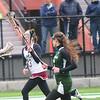 JIM VAIKNORAS/Staff photo Newburyport girls lacrosse player #13 advances the ball against Bonny Eagle at Newburyport.
