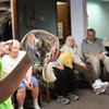 BRYAN EATON/Staff Photo. Sarah Soucy of Curious Creatures shows off Lila a chinchilla at the Assisted Living Center in Salisbury. The center always has the animal group that takes in unwanted exotic pets give a presetation during Earth Day.