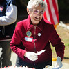 JIM VAIKNORAS/Staff photo Beth Thomson serves cake during the 100th Birthday party for the Harold Parker State Forest Saturday. Almost 700 people attended the event enjoyed  hot dogs, games, fishing, and programs to learn about the history of the forest.