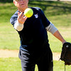 JIM VAIKNORAS/Staff photo Over 60 softball player Matt LaScola, 74 practices his slow pitch at Carl Thomas Field in North Andover.