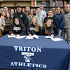 BRYAN EATON/Staff Photo. Signing letters of intent, from left, Julia Hartman, Maddie Quigley and Emma McGonagle.