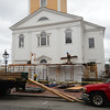 JIM VAIKNORAS/Staff photo Workers remove scaffoling from the Unitarian Universalist Church on Pleasant Street in Newburyport Friday.