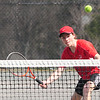 JIM VAIKNORAS/Staff photo Amesbury's Cooper Wigglesworth returns a ball during his 1st doubles match against Triton at Amesbury.