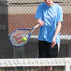 JIM VAIKNORAS/Staff photo Triton's Brandon Barrett returns a ball during his 1st double match at Amesbury. Tennis at Amesbury.
