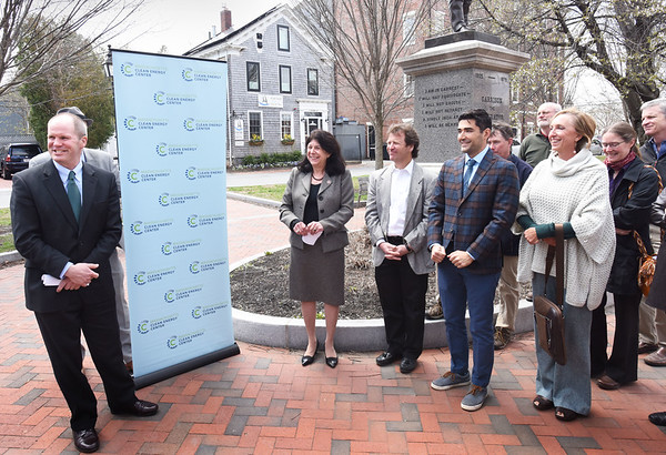 BRYAN EATON/Staff photo. Massachusetts Clean Energy Center CEO Stephen Pike, left, was joined by Newburyport Mayor Donna Holaday, center, to announce the next round of Solarize Mass communities as part of the Commonwealth's Earth Week celebration on Wednesday. Pike also announced the launch of Mass Solar Connect, a new non-profit based solar program.
