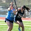 JIM VAIKNORAS photo  Pentucket's Jacqui Cloutier fights for the ball with Triton's Hope Leonard at Triton Friday.