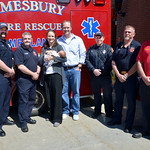 JIM VAIKNORAS photo Kevin and Hillary Sheridan along with their baby Henry are flanked by Amesbury fire fighters Ryan York, Jim Bateman, Jamie Clark, Brian Dixon, and Carl Rizzo. The fire fi ...