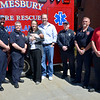 JIM VAIKNORAS photo Kevin and Hillary Sheridan along with their baby Henry are flanked by Amesbury fire fighters Ryan York, Jim Bateman, Jamie Clark, Brian Dixon, and Carl Rizzo. The fire fighters assisted in the birth of Young Henry.