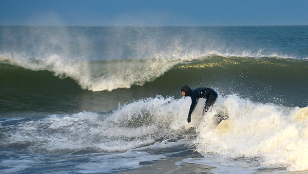 JIM VAIKNORAS/Staff photo Steve Peterson of Newburyport catches a wave in the late afternoon at Salisbury Beach Friday afternoon.