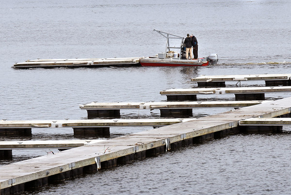 BRYAN EATON/Staff photo. The nice weather has given boatyards a jump start on putting in docks in the Merrimack River for the boating season.