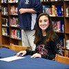 BRYAN EATON/Staff photo. Triton runner Marissa Farago is signed her National Letter of Intent to play in college.