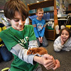 "BRYAN EATON/Staff photo. Jake Kramich, 9, shows off his pet hampster Humphrey to his classmates in Bethany Marshall's class at Salisbury Elementary School. The students read author Betty Birney's first installment of the ""Humphrey"" series, which is about a hampster, and Jake said he had a hampster with that name. Each child is now creating their own story of what Humphrey's next adventure could be."