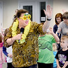 BRYAN EATON/Staff photo. Salisbury entertainer and singer Nancy Sweeney teach youngsters the Cuban musical dance form the Mambo on Thursday afternoon. She was at the Salisbury Public Library for one of the school vacation presentations.