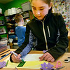 BRYAN EATON/Staff photo. Aida Gross, 11, decorates a birthday card with cut-outs of flowers in the craft room at the Newburyport Rec Center on Thursday afternoon. She was making the card for counselor Lee Gordon's mother Karen.
