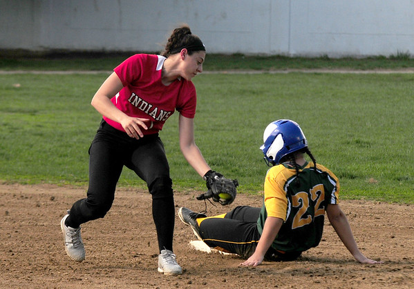 JIM VAIKNORAS/staff photo Amesbury's Maddi Napoli is late with a tag as a runner steals second against North Reading riday afternoon at Perry Field in Amesbury.
