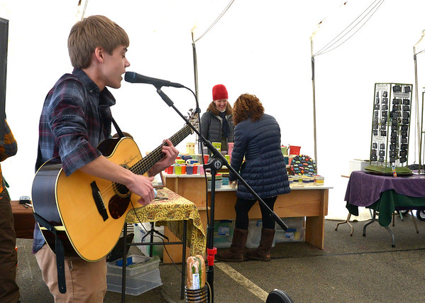 JIM VAIKNORAS/Staff photo Quentin Callewaert performs at the Newburyport Farmers Market at the Tannery Sunday morning. This week was the last indoor market of the season with the summer market starting May 7.