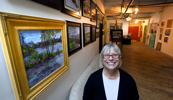 BRYAN EATON/Staff photo. Barbara Lorenc, owner of 14 Cedar Street in Amesbury is celebrating 15 years of rehabbing the former mill building into artists lofts among other businesses.