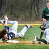 BRYAN EATON/Staff photo. Pentucket short stop Jacob Deziel scrambles for the ball as Triton's Christian O'Brien safely steals second with some controversy.