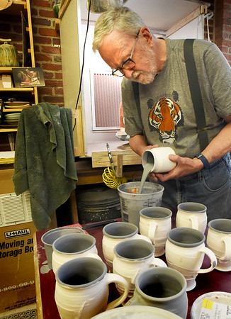 BRYAN EATON/Staff photo. Pottery artisan Roger Cramer has been at 14 Cedar Street for several years.