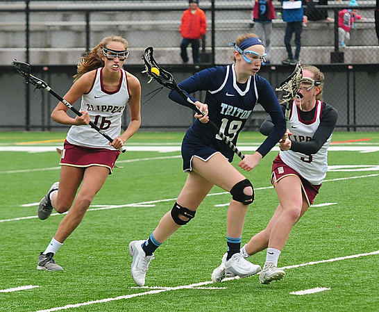 JIM VAIKNORAS photo Triton's Paige Volpone advances the ball during the Viking's games against Newburyport a War Memorial Stadium in Newburyport Friday.