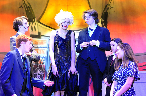 "JIM VAIKNORAS photo Liam Gately as RF Simpson,Christian Kjaer as Cosmo Brown, Sadie Fountain as Lina Lamont, Vincent KcKeown as Don Lockwood, Ella Wallace as Roz, and Isa Garcia as Kathy Selden in the Nock Middle School production of ""Singing in The Rain"""