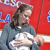 JIM VAIKNORAS photo Hillary Sheridan holds her  baby Henry. The young man was delivered at home with the help on the Amesbury Fire Dept.