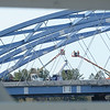 BRYAN EATON/Staff photo. Workers check the arches of the southbound span of the Whittier Bridge on the Newburyport side framed by the sides of the Chain Bridge, down river from the construction site.